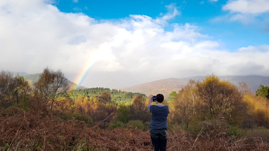 Gemma at Three Lochs Peak with Rainbow