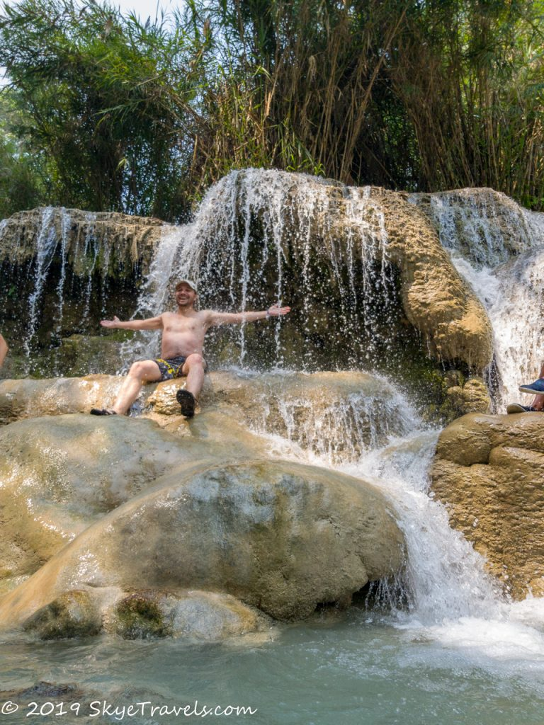 Sitting on the Kuang Si Waterfalls